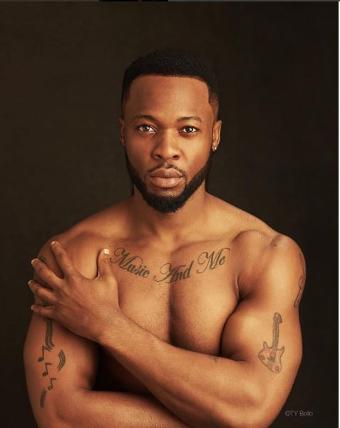 This Latest Photo Of Flavour With Half Naked Woman Has Got People Guessing