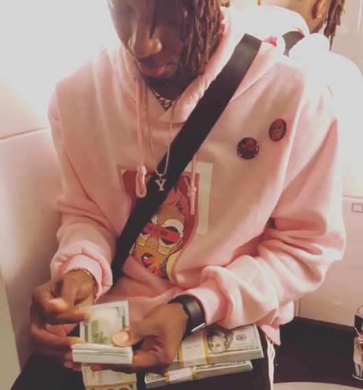 Rapper Yung6ix Shows Off Stacks Of $100 Bills