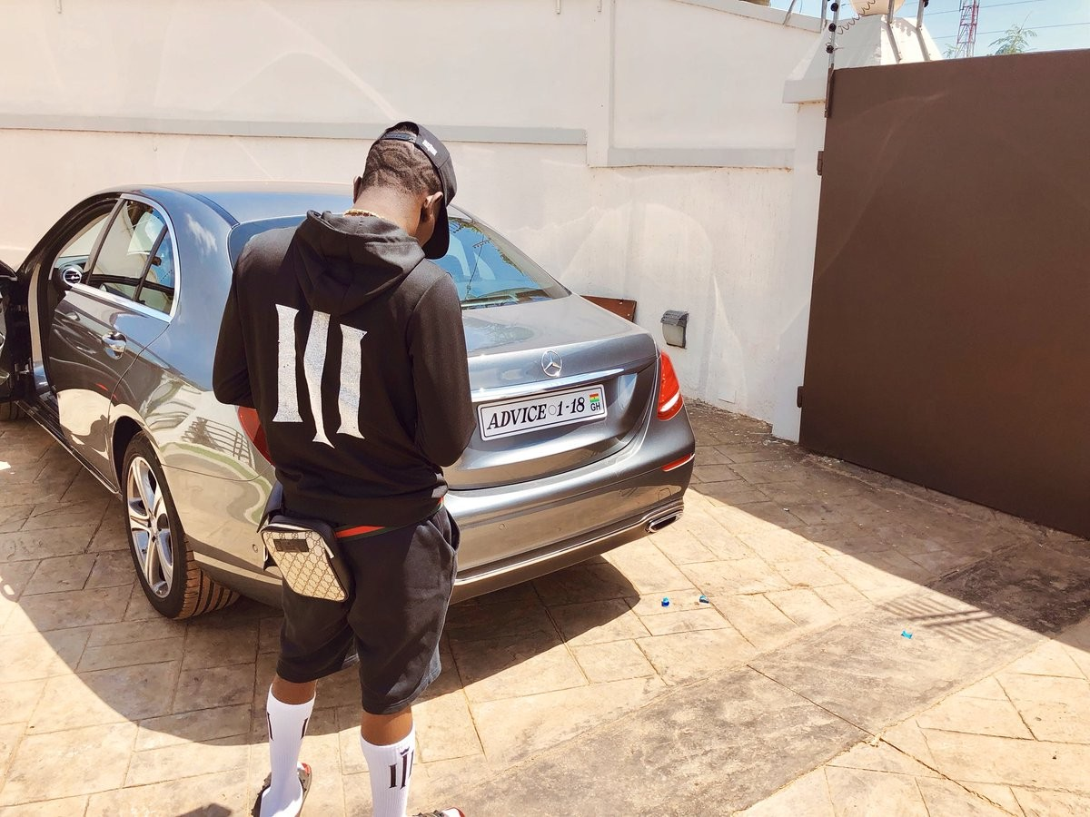 Posing with the new whip: Shatta Wale wrote: 'Advice well taken..Mercedes Benz no Dey talk .