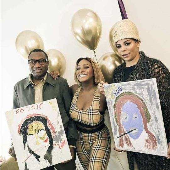 Photo Of The Day: DJ Cuppy's parents paint a portrait of her