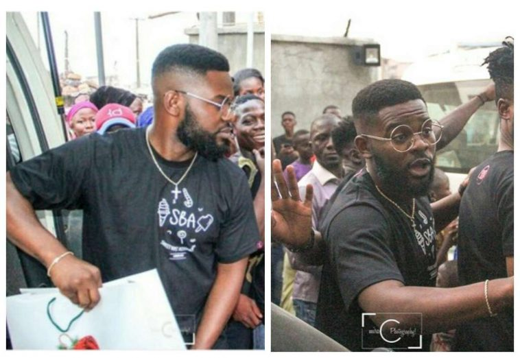 [PHOTOS] Falz Spotted Giving Christmas Gifts To People