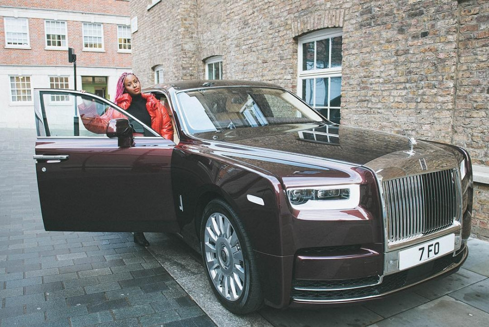 DJ Cuppy with the Rolls Royce; Takes Possession Of Her New Ride