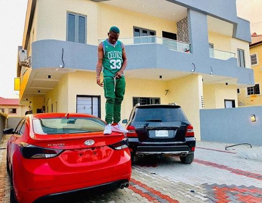 [PHOTO] Zlatan Ibile Buys Himself Two New Cars And A House