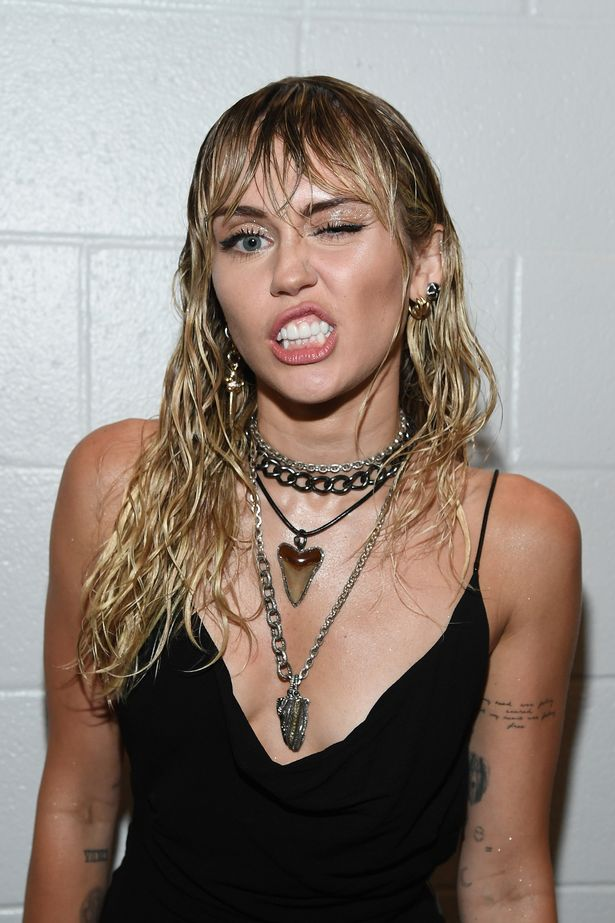 Miley Cyrus unveils new tattoo at VMAs hinting at dark reason for Liam Hemsworth split