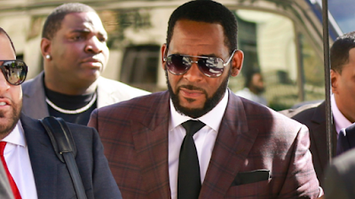 R Kelly charged with two counts of child prostitution
