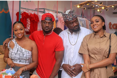 Paul and Jude Okoye pose with their wives