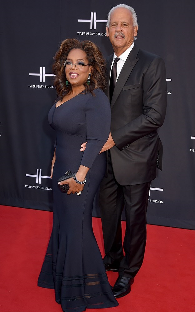 65 year-old Oprah Winfrey does a prom pose with beau