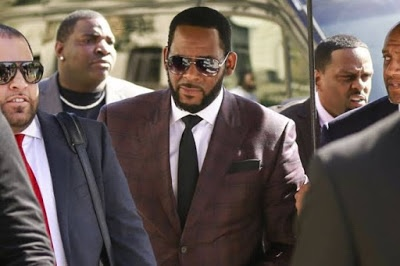 R. Kelly's friends charged with harassing witnesses linked to Singer's case