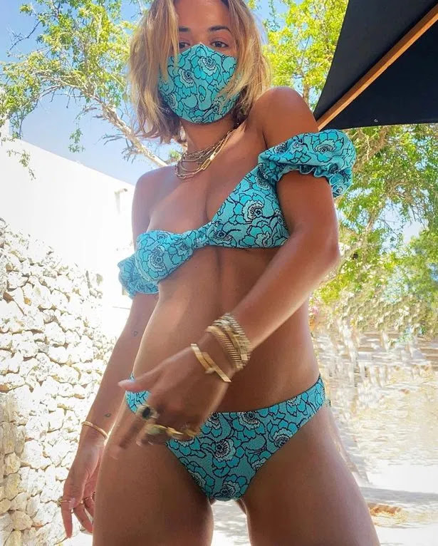 Rita Ora sizzles while staying safe in Ibiza by matching her bikini to her mask
