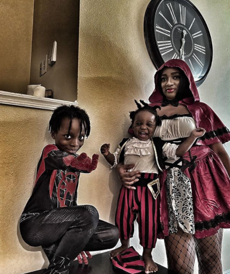 Cute photo of Olamide's partner and their children in Halloween costumes