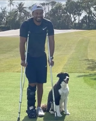 Tiger Woods steps out in crutches