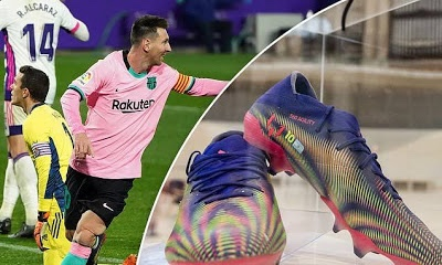 Messi's record-breaking boots auctioned for £125,000