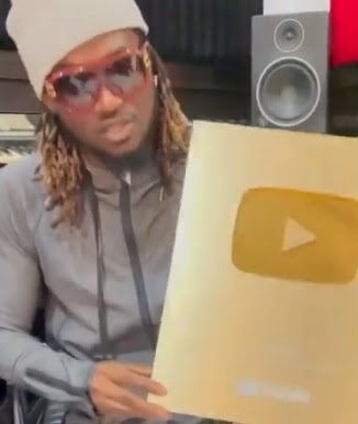 Rudeboy shows off YouTube Plaque after hitting 100m views
