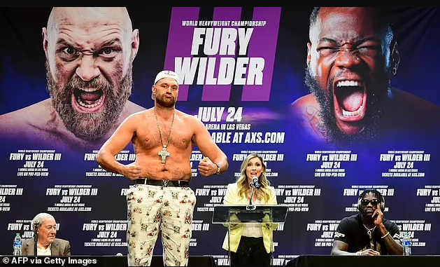 Tyson Fury tests positive for Covid-19 as Deontay Wilder fight is postponed